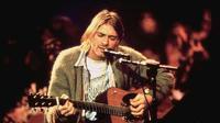 Kurt Cobain dan cardigan abu-abu historisnya.