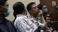 Terdakwa dugaan suap jual beli jabatan di lingkungan Kemenag, M Romahurmuziy jelang menjalani sidang lanjutan di Pengadilan Tipikor, Jakarta, Senin (23/9/2019). Sidang beragendakan pembacaan eksepsi yang dibacakan terdakwa dan penasehat hukum terdakwa. (Liputan6.com/Helmi Fithriansyah)