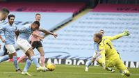 Manchester City meraih kemenangan 1-0 atas Sheffield United pada laga pekan ke-21 Premier League di Stadion Etihad, Sabtu (30/1/2021) malam WIB. (Martin Rickett/Pool via AP)