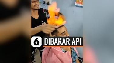 Sebuah salon di Mumbai, India, menawarkan sensasi cukur rambut yang tak biasa. Di sini, rambut pelanggan dicukur dalam keadaan terbakar api.