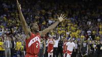 Ekspresi Kawhi Leonard pebasket andalan Toronto Raptors merayakan titel juara NBA pertama bagi klub Raptors. Di gim keenam ia berhasil mencetak 22 poin. (AP Photo/Ben Margot)