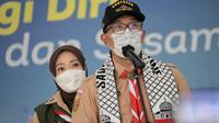 Gubernur Jawa Barat Ridwan Kamil berkomunikasi virtual dengan Wakil Menteri Kesehatan Palestina Yousef Abu al Rish saat memberikan bantuan senilai Rp1,5 miliar untuk rakyat Palestina, Senin (14/6/2021). (Foto: Pipin/Biro Adpim Jabar)