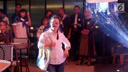 Anak-anak berbakat disabilitas membawakan karya seni pada perayaan 50 tahun Plan International Indonesia di Jakarta, Jumat (20/9/2019). Desain kolaborasi yang mengangkat tema kesetaraan anak-anak perempuan dibawakan oleh anak-anak disabilitas dari Glowing Star. (Liputan6.com/Fery Pradolo)