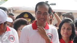 Presiden Joko Widodo didampingi Ibu Negara Iriana Jokowi saat menghadiri acara peringatan Hari Anti Narkotika Internasional (HANI) di kawasan Taman Sari, Jakarta, Minggu (26/6). (Liputan6.com/Herman Zakharia)