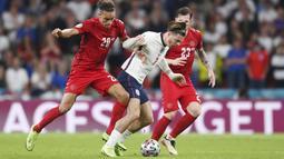 Jack Grealish - Kehadiran pemain Aston Villa yang masuk menggantikan Bukayo Saka di menit 69 ini membuat sektor kiri serangan Inggris menjadi lebih hidup. Pergerakannya benar-benar membuat para bek Denmark kocar-kacir. (Foto:AP/Laurence Griffiths, Pool)