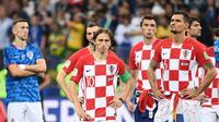 Luka Modric dan para pemain Timnas Kroasia tak mampu menahan kesedihan setelah gagal menjuarai Piala Dunia 2018. (AFP/Franck Fife)