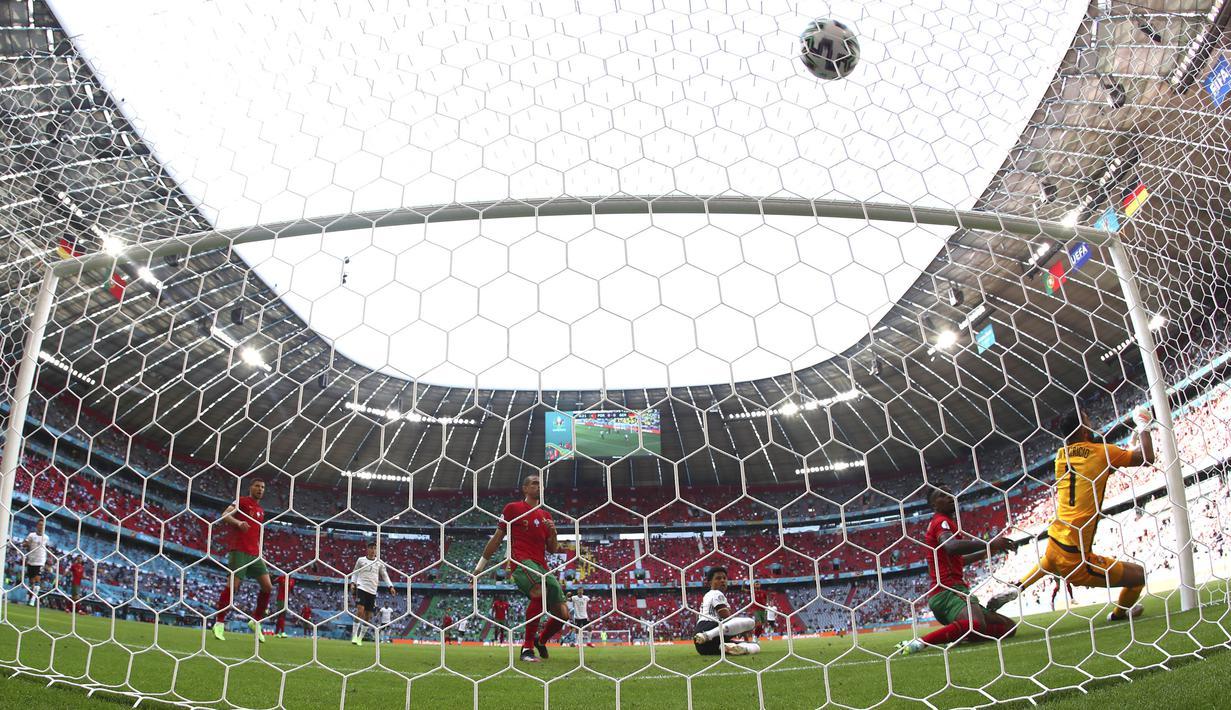 Jerman sukses memperpanjang nafas mereka di fase grup setelah tumbangkan Portugal. Pertandingan antara negara unggulan Euro 2020 (Euro 2021) diwarnai dengan gol yang saling berbalas. (Foto: AP/Matthias Schrader)