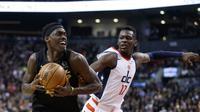 Aksi Pascal Siakam menerobos pertahanan lawan saat Raptors mengalahkan Wizards (AP)