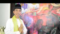 Presiden terpilih Joko Widodo mengenakan busana ala Betawi (Liputan6.com/Herman Zakharia)