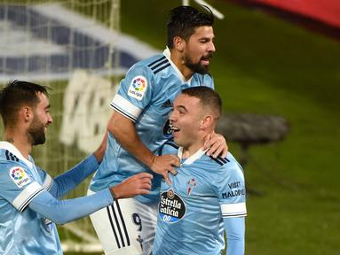 Penyerang Celta Vigo, Iago Aspas, merayakan gol yang dicetaknya ke gawang Cadiz pada laga lanjutan Liga Spanyol di Stadion Abanca Balaidos, Selasa (15/12/2020) dini hari WIB. Celta Vigo menang telak 4-0 atas Cadiz. (AFP/Miguel Riopa)