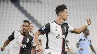 Bintang Juventus Cristiano Ronaldo merayakan golnya ke gawang Lazio pada pekan ke-34 Liga Italia di Allianz Stadium, Selasa (21/7/2020) dini hari WIB. (Marco Alpozzi/LaPresse via AP)