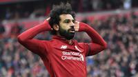 6.Mohamed Salah (Liverpool) - Salah mencatatkan rekor sebagai pemain dengan gol terbanyak dalam 100 penampilan bersama Liverpool. Bukan tidak mungkin, Salah menjadi calon kuat peraih gelar top skor di Liga Champions musim ini. (AFP/Paul Ellis)
