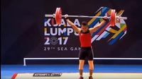 Deni berhasil merebut medali emas SEA Games 2017 dari cabang angkat berat kelas 69kg  (vidio.com)