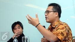 Koordinator Elsam, Wahyudi Djafar (kanan) memberikan pernyataan saat peluncuran Laporan HAM 2015 Amnesty International di Jakarta, Rabu (24/2/2016). Amnesty International meluncurkan buku Laporan HAM sepanjang 2015. (Liputan6.com/Helmi Fithriansyah)