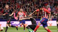 Diego Costa mencetak gol tunggal kemenangan Atletico Madrid atas Arsenal pada laga leg kedua semifinal Liga Europa di Estadio Wanda Metropolitano, Kamis (3/5/2018) waktu setempat. (AFP/PIERRE-PHILIPPE MARCOU)