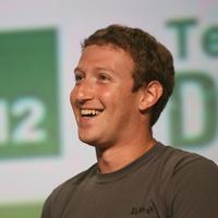 Tawa Mark Zuckerberg sebelum dirundung masalah pencurian data pengguna Facebook. (AFP/Kimihiro Hoshino)