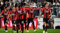 AC Milan memupuskan kemenangan tuan rumah, setelah Ante Rebic (kanan kedua) sukses membobol gawang Juventus. Rebic sukses mengkonversi umpan sepak pojok Sandro Tonali untuk menyamakan kedudukan menjadi satu sama dan bertahan hingga akhir laga. (AFP/Isabella Bonotto)