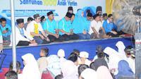 KNPI menggelar santunan 1.000 anak yatim.