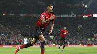 Strimer Manchester United (MU) Marcus Rashford merayakan gol ke gawang Brighton & Hove Albion pada lanjutan Liga Inggris di Old Trafford, Sabtu (19/1/2019). (AP/Martin Rickett)