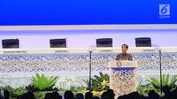 Presiden Joko Widodo menyampaikan sambutan pada Pertemuan Tahunan IMF-WB Group 2018, Bali, Jumat (12/10). Dalam pidatonya, Jokowi mengumpamakan kondisi ekonomi global sekarang seperti cerita serial televisi Game of Thrones. (Liputan6.com/Angga Yuniar)