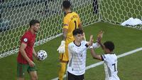 Kai Havertz. Striker Jerman berusia 22 tahun ini telah mencetak 2 gol di fase grup saat bersua Portugal dan Hongaria. Bahkan saat kontra Portugal, selain 1 gol yang dicetaknya, dirinya juga berperan besar dalam 2 gol bunuh diri Portugal. (Foto: AP/Pool/Matthias Hangst)