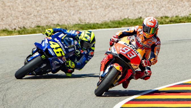 Ilustrasi persaingan Marc Marquez dan Valentino Rossi di MotoGP. (Robert MICHAEL / AFP)#source%3Dgooglier%2Ecom#https%3A%2F%2Fgooglier%2Ecom%2Fpage%2F%2F10000