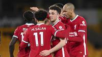 Para pemain Liverpool merayakan gol yang dibuat striker Diogo Jota (kedua dari kanan) ke gawang Wolverhampton Wanderers dalam laga lanjutan Liga Inggris 2020/2021 pekan ke-28 di Molineux Stadium, Senin (15/3/2021). Liverpool menang 1-0 atas Wolverhampton. (AP/Laurence Griffiths/Pool)
