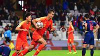 Thailand takluk 1-2 dari China pada 16 Besar Piala Asia 2019 di Hazza Bin Zayed Stadium, Al Ain, Minggu (20/1/2019). (Giuseppe CACACE / AFP)