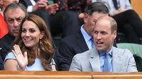 Kate Middleton dan Pangeran William di pertandingan ke-13 Wimbledon Championships di Wimbledon, Inggris, 14 Juli 2019. (BEN STANSALL / AFP)