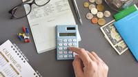Ilustrasi menghitung keuangan (Foto:Shutterstock).