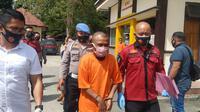 Polres Bone Bolango (Bonebol) akhirnya merilis kasus penangkapan Karimu (31) atau orang lokal menyebutnya Kolor Ijo Gorontalo. (Arfandi Ibrahim/Liputan6.com)