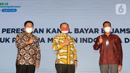 Bank Mandiri melalui Mandiri International Remittance (MIR) melayani pembayaran iuran BPJamsostek bagi PMI di Malaysia agar lebih mudah dan cepat. PMI hanya perlu melakukan registrasi pada website BPJamsostek untuk mendapatkan kode pembayaran. (Liputan6.com/Fery Pradolo)