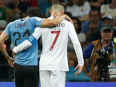 Kembalinya Cristiano Ronaldo yang sudah identik dengan sebutan CR7 ke Manchester United menimbulkan polemik soal nomor punggung yang akan digunakan. Di luar dugaan, Edinson Cavani dengan legowo mau memberikan nomor tersebut kepada CR7. Berikut kronologinya. (Foto: AFP/Odd Andersen)