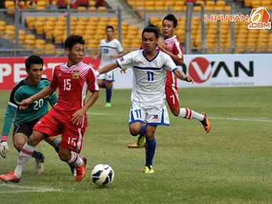Sesekali Xouxana Sihalath agresif menjaga pertahanan Laos dari gempuran serangan Filipina (Liputan6.com/ Helmi Fithriansyah)