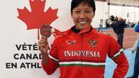 Dedeh Erawati berhasil menyabet medali emas lari gawang pada kejuaraan masters di Kanada. (Bola.com/Andhika Putra)