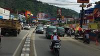 Warga Jayapura tetap menjalankan aktivitas seperti biasanya, pasca diumumkan virus corona telah masuk ke Indonesia. (Liputan6.com/Katharina Janur)