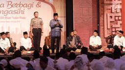 Wapres Jusuf Kalla memberikan sambutan dalam acara Himbara buka puasa bersama anak yatim di JCC, Jakarta, Kamis (15/06). Himbara menyerahkan bantuan penunjang pendidikan senilai Rp200 juta.(Liputan6.com/Fery Pradolo)