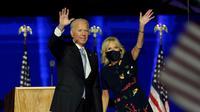 Joe Biden dan istri. (dok. Andrew Harnik / POOL / AFP)