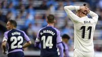 Ekspresi pemain Real Madrid, Gareth Bale, saat melawan Real Valladolid pada laga La Liga, di Santiago Bernabeu, Madrid, Sabtu (3/11/2018). (AFP/Javier Soriano)
