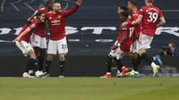 Manchester United mengalahkan Tottenham Hotspur 3-1 pada laga lanjutan Liga Inggris 2020/2021 di Tottenham Hotspur Stadium, London, Minggu (11/4/2021). (AFP/Mathew Childs)