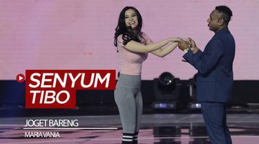 Berita video momen Titus Bonai joget dan olahraga bareng si cantik Maria Vania di atas panggung Konser Luar Biasa Indonesian Soccer Awards 2019. Momen tersebut membuat Tibo senyum tersipu.
