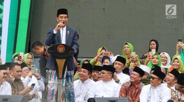 Berkain Sarung, Jokowi Hadiri Harlah ke-73 Muslimat NU