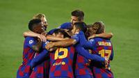 Para pemain Barcelona merayakan gol ke gawang Napoli dalam leg kedua babak 16 besar Liga Champions, Minggu (9/8/2020) dini hari WIB. (AP Photo/Joan Monfort)