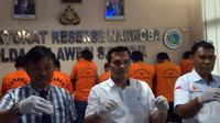 Kasubdit II Dirtres Narkoba Polda Sulsel, AKBP Musa, dalam ekspos penangkapan anak Wabup Maros, di Mapolda Sulsel, Kamis (8/3) (Syahrul Ramadan/JawaPos.com)
