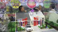 Sebuah miniatur rumah terlihat saat pameran Property Week 2015 di Jakarta, Kamis (17/9/2015). 140 pengembang mengisi pameran tersebut dan di harapkan dapat mengembalikan dinamisme industri properti di dalam negeri. (Liputan6.com/Angga Yuniar)