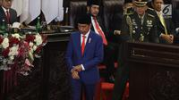 Presiden Joko Widodo atau Jokowi turun dari mimbar usai menyampaikan Pidato Kenegaraan pada Sidang Tahunan MPR 2019 di Kompleks Parlemen, Senayan, Jakarta, Jumat (16/8/2019). Jokowi akan menyampaikan pidato dalam tiga sesi dengan tema yang berbeda selama acara berlangsung. (Liputan6.com/Johan Tallo)