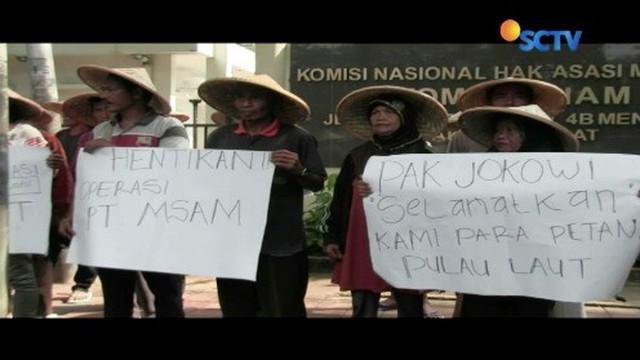 Puluhan petani asal Kalsel berunjuk rasa di kantor Komnas HAM Jakarta. Mereka mengaku lahannya dicaplok perusahaan kelapa sawit.