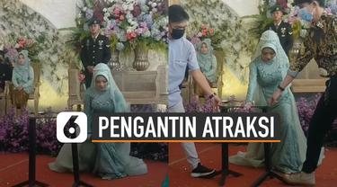 Aksi hebat ditunjukkan oleh seorang mempelai wanita saat resepsi pernikahan.
