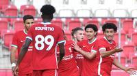 Pemain-pemain Liverpool FC saat tampil dalam laga persahabatan (Barbara Gindl/AFP)