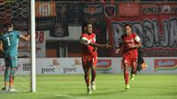 Pemain Persija, Ramdani Lestaluhu (kiri) dan Novri Setiawan merayakan gol ke gawang Borneo FC di Piala Presiden 2019, (Dok Persija)